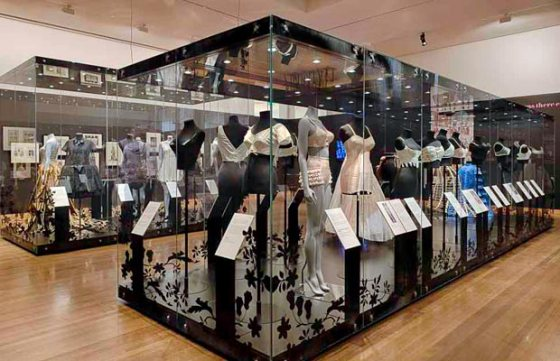 The oldest bra in the collection is the garment closest to the front corner of the glass cabinet